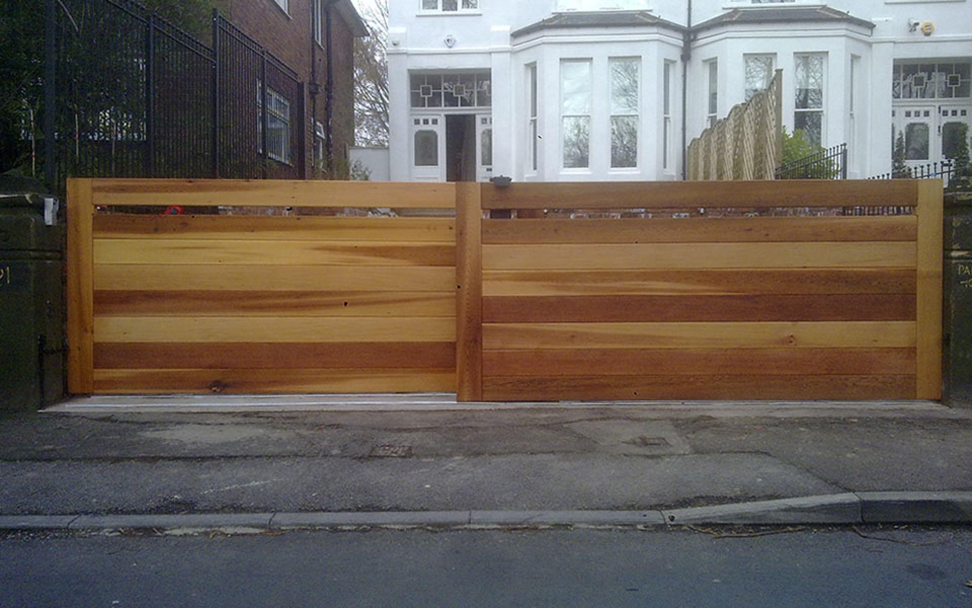 Contemporary cedar sliding gates (Courtesy of Country Gates)