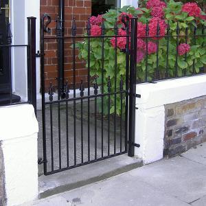 Wrought iron pedestrian garden gate and railings
